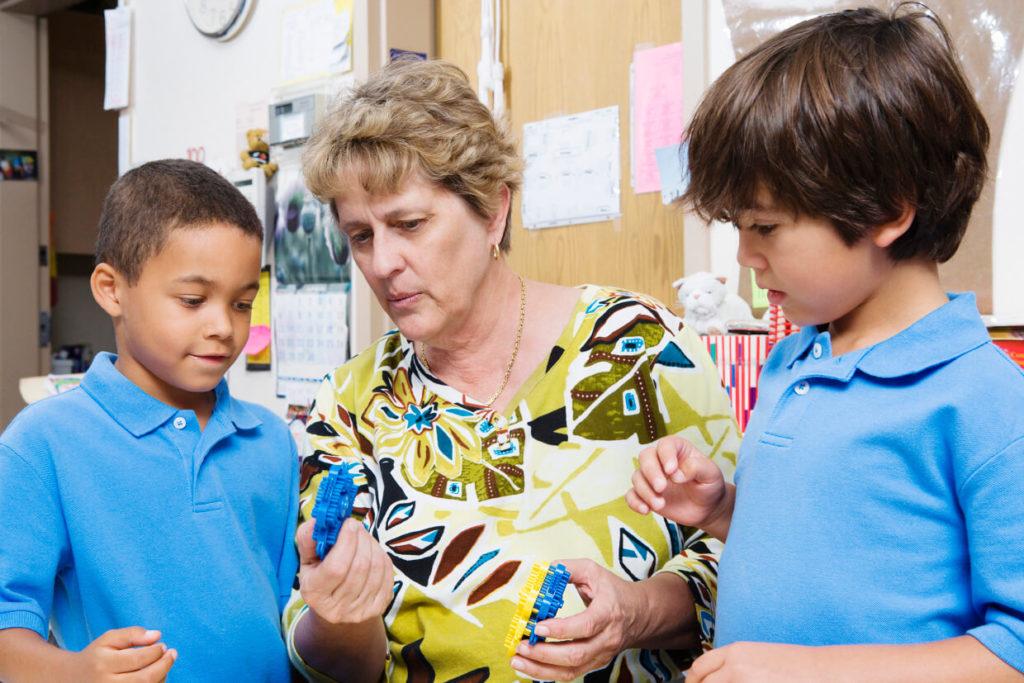 Teacher with two boys